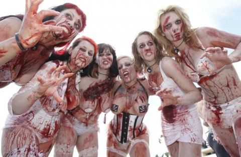 "Film extras pose on the beach during a photocall for the film ""Zombie Women Of Satan"" as the 63rd Cannes Film Festival continues"