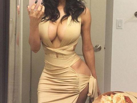 【画像】巨乳美女+タイトドレスが最強すぎるんやが。。(38枚)